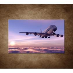 Obrazy na stenu - Lietadlo v oblakoch